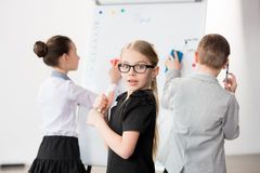 Children working in office. Like adult business people Royalty Free Stock Image