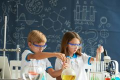 Children working with reagents royalty free stock photos