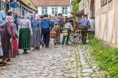 Children working on the streets of Denmark. Aarhus, Den Gamle By spectacle of danish old traditions Royalty Free Stock Image