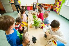 Children learning about plants at a workshop. Children at a workshop learning about plants and natural oils Stock Images