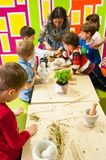 Children learning about plants at a workshop. Children at a workshop learning about plants and natural oils Stock Photo