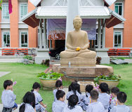 Children worship Buddha Image Stock Image