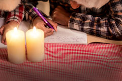 Children write letter on Christmas. Royalty Free Stock Photography