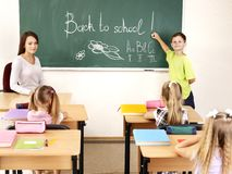 Children writing on blackboard. Stock Images