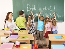 Children writing on blackboard. Royalty Free Stock Photos