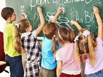 Children writing on blackboard. Stock Image