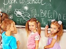 Children writing on blackboard. Royalty Free Stock Photography