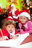 Children writing a Christmas letter Royalty Free Stock Images
