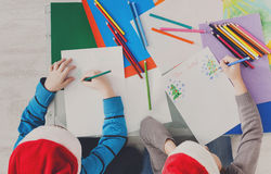 Children writing letter to santa, wait for christmas, top view Stock Images