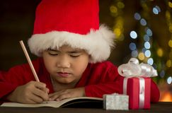 Children are writing letters to Santa Stock Photos