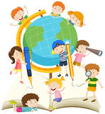 Children writing and reading book Stock Photography