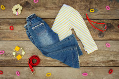 Children's clothing and accessories: jeans, jacket, hair clips, necklace and bracelet Royalty Free Stock Photography