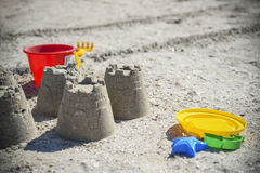 Children& x27;s fun on the beach, toys and built castles, summer rest Stock Image