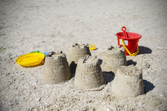 Children& x27;s fun on the beach, toys and built castles, summer rest Stock Images