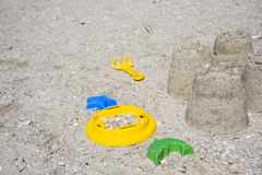 Children& x27;s fun on the beach, toys and built castles, summer rest Royalty Free Stock Image