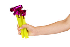 Children's hand and toy Royalty Free Stock Images