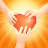 Children's hands hold heart. Stock Photo