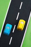 Children's highway with yellow and blue cars. Royalty Free Stock Image