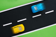 Children's highway with yellow and blue cars. Stock Photos