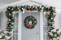 Children's room. Green fir-tree with red and gold Christmas toys  door on the veranda Royalty Free Stock Image