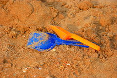 Children& x27;s sand toys , two shovels on snady surface Royalty Free Stock Image