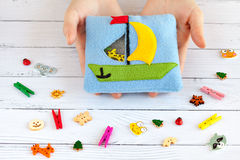 Children's toy made of colored fleece for the development motor skills. Stock Photos