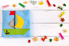 Children's toy made of colored fleece for the development motor skills. Stock Photography