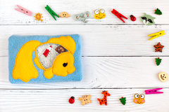 Children's toys made of colored fleece for motor development. Bag with yellow fish filled plastic beads and figurines Stock Photography