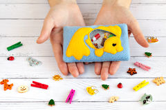 Children's toys made of colored fleece for motor development. Bag with yellow fish filled plastic beads and figurines Stock Photo