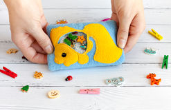 Children's toys made of colored fleece for motor development. Bag with yellow fish filled plastic beads and figurines Royalty Free Stock Photography