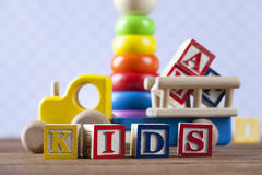 Children's World toy on a wooden background. Stock Images