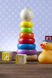 Children's World toy on a wooden background. Royalty Free Stock Images