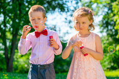 Children 6 years old doing soap bubbles Royalty Free Stock Photo