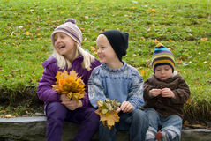 Children with yellow leafs Royalty Free Stock Photography