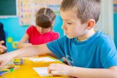 Childrenat kindergarten stock photo