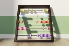 Children s colored abacus near wall. Childrens abacus with colorful beads standing on the wooden floor of a green and white striped nursery. 3d rendering Stock Photo