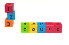 Childrens alphabet blocks. Childrens alphabet spelling blocks used to spell out the word spell and 123 Stock Image