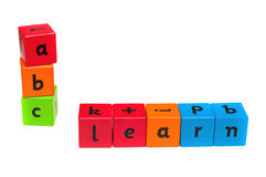 Childrens alphabet learning blocks. Childrens alphabet blocks used to spell out the words learn and abc, so children can have fun whilst learning Royalty Free Stock Image
