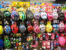 Childrens bicycle safety helmets. Children's colorful bicycle safety helmets in a shop display. This display is in the Halfords store situated in Bedford Stock Photography
