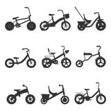 Childrens bicycles silhouettes royalty free illustration