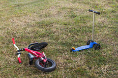 Childrens bike and scooter Royalty Free Stock Image