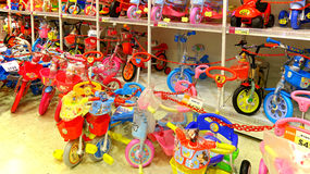 Childrens bikes in a toy store Stock Photos