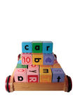 Childrens blocks spell car in wooden cart Stock Photo