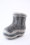 Childrens bootee connected from a wool. Removed close up on a white background without isolation Royalty Free Stock Photo