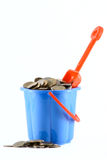 Childrens bucket with coins a scoop Stock Photography