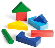 Childrens building blocks on a white background. Childrens colorful building blocks on a white background Stock Photo