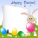 Childrens card for Easter with painted eggs and rabbit on floral meadow. Place for text Stock Photos