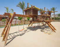 Childrens climbing frame in park. Childrens climbing frame jungle gym outside in tropical park area royalty free stock images