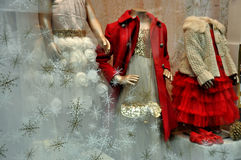 Childrens clothing shop window Stock Photo