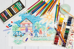 Childrens Creation With Sketch And Paints. Hand drawn Bright Childrens Sketch With Happy Family, House, Dog, Car on the Lawn with Flowers with lying flat pencils Royalty Free Stock Image